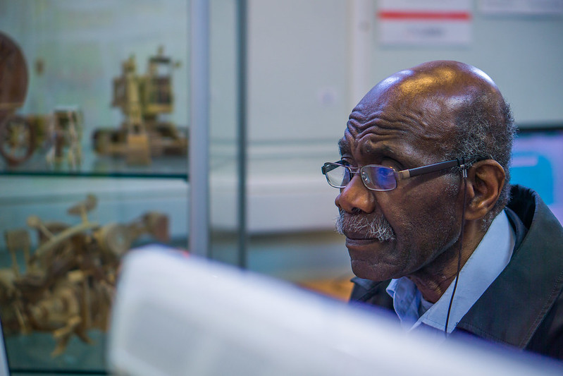 Black pensioner using a library computer