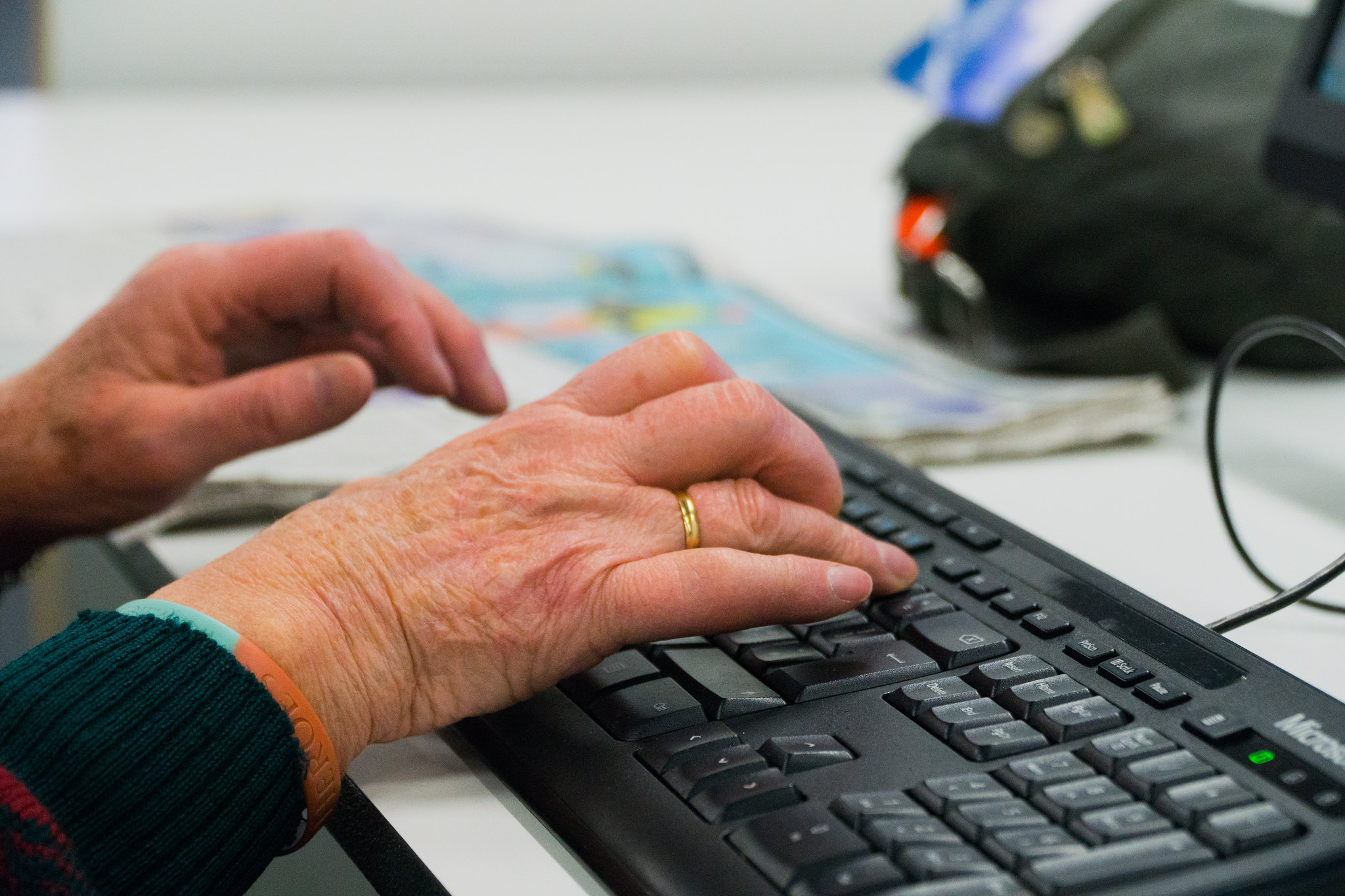 Elderly woman's hands on a keyboard