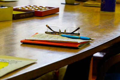 A pair of glasses rests on a notepad