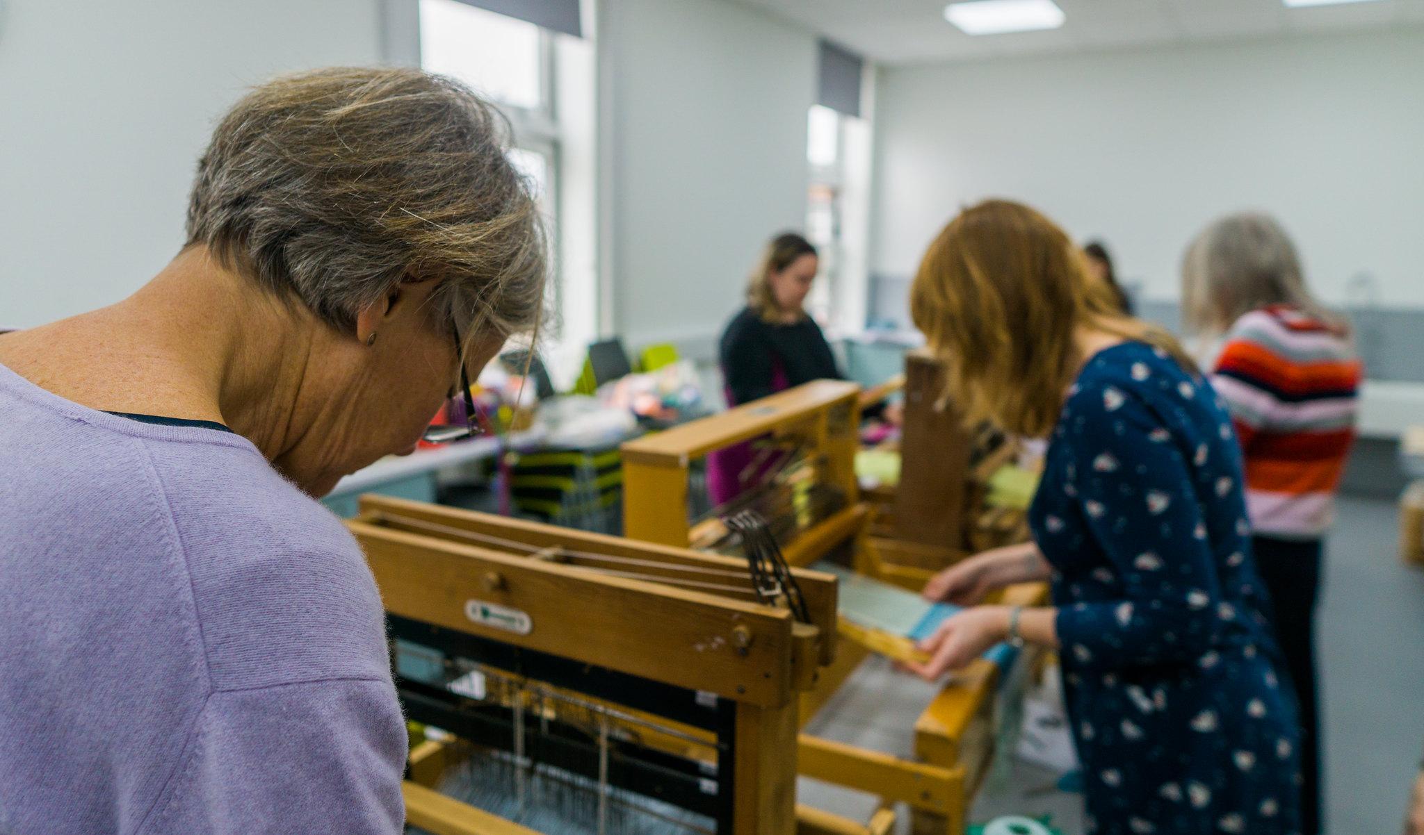 Women in a library weaving