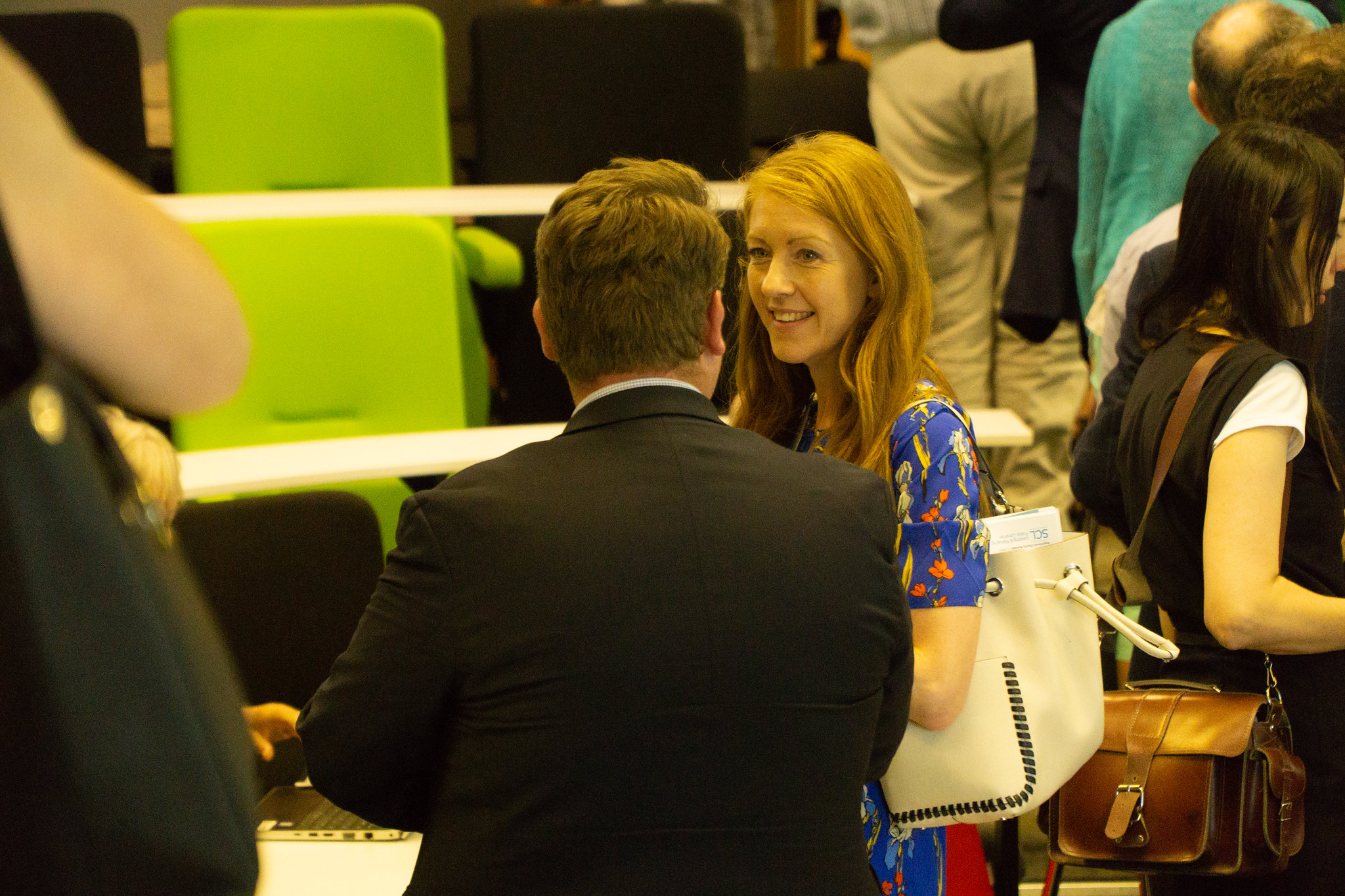 Delegates networking at a seminar