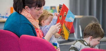 Mother reading with her young child